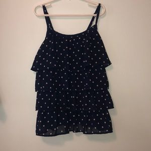 navy blue shirt with white polka dots